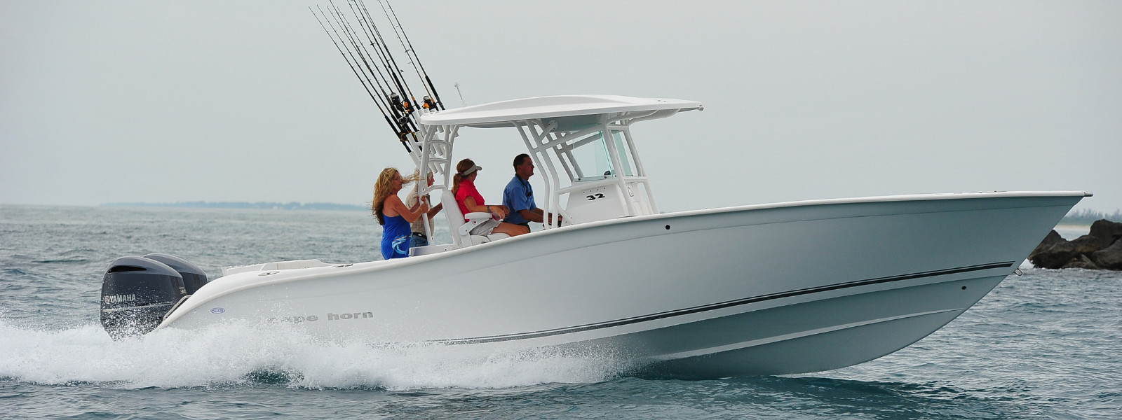 cape-horn-white-32-on-water-fishing-gear-and-3-people